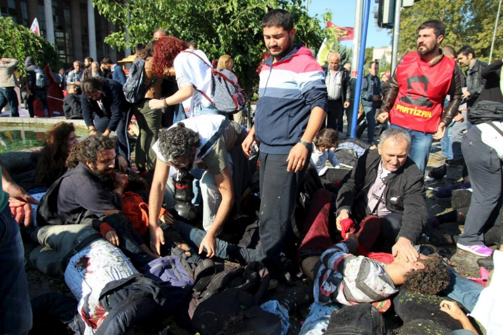 People are seen at the blast scene afetr explosion during a peace march in Ankara