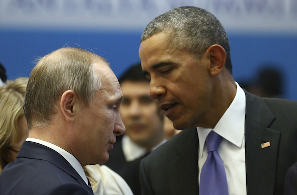 U.S. President Barack Obama , right, talks with Russian President Vladimir Putin, left, prior to a session of the G-20 Summit in Antalya, Turkey, Monday, Nov. 16, 2015. The leaders of the Group of 20 were wrapping up their two-day summit in Turkey Monday against the backdrop of heavy French bombardment of the Islamic State's stronghold in Syria. The bombings marked a significant escalation of France's role in the fight against the extremist group.(Kayhan Ozer/Anadolu Agency via AP, Pool)