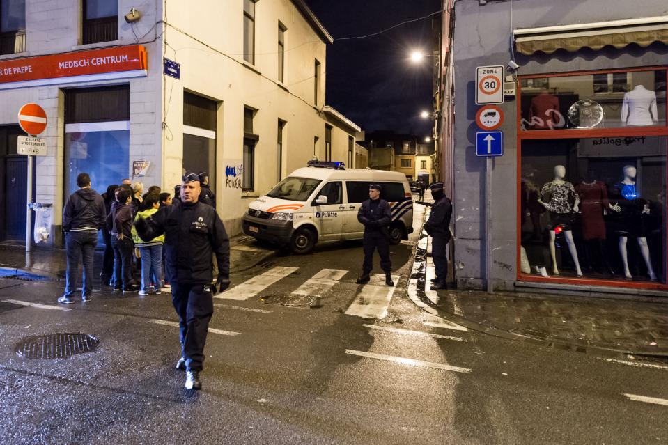 FILE - In this Tuesday, Nov. 17, 2015, file photo, police guard a street in which special intervention forces searched a house in the Molenbeek neighborhood in Brussels. Molenbeek is separated from the Midi section of Brussels by part of a mosaic of jurisdictions of 19 municipalities and 6 policing zones, all for a population of 1 million, long hampering cooperation. (AP Photo/Geert Vanden Wijngaert, File)