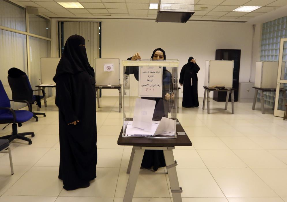Saudi women vote at a polling center during municipal elections, in Riyadh, Saudi Arabia, Saturday, Dec. 12, 2015. Saudi women are heading to polling stations across the kingdom on Saturday, both as voters and candidates for the first time in this landmark election. (AP Photo/Aya Batrawy)