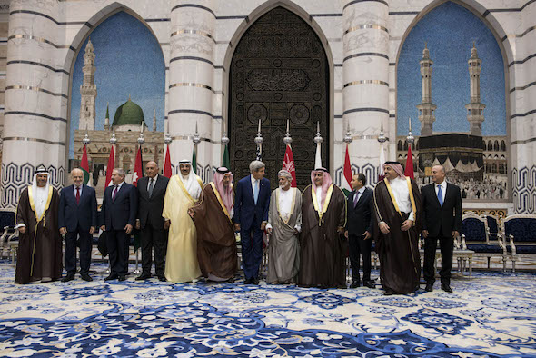 U.S. Secretary of State John Kerry, center, poses with his Arab counterparts for a group photo after a meeting with them in Jiddah, Saudi Arabia, Thursday, Sept. 11, 2014. Kerry's visit, on the anniversary of the 9/11 attacks, was aimed at pinning down Middle Eastern allies on what support they are willing to give to U.S. plans to beat back the Islamic State group, which has seized large chunks of Iraq and Syria. (AP Photo/Brendan Smialowski, Pool)