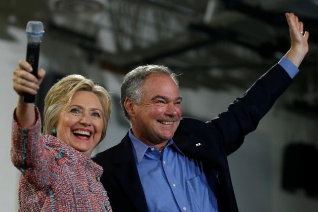 Democratic U.S. presidential candidate Hillary Clinton and U.S. Senator Tim Kaine (D-VA) wave to the crowd during a campaign rally at Ernst Community Cultural Center in Annandale, Virginia, U.S., July 14, 2016. REUTERS/Carlos Barria