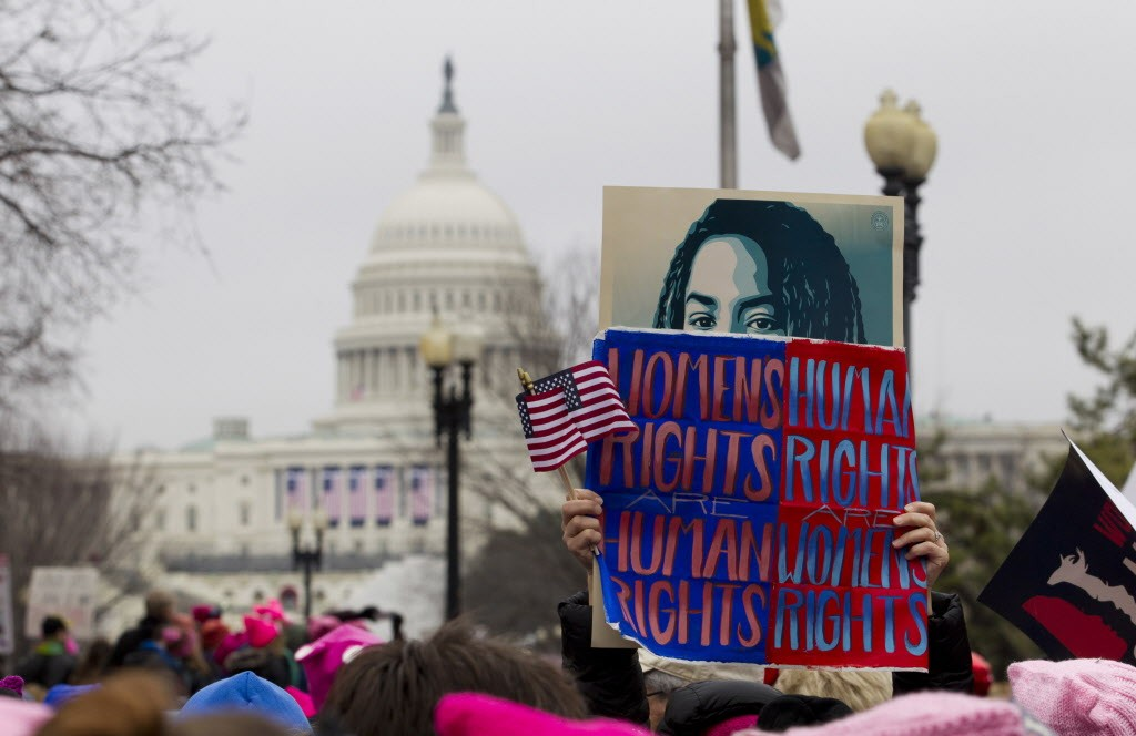 Women rally at Capitol Hill as they make their voices heard on the first full day of Donald Trump's presidency, Saturday, Jan. 21, 2017 in Washington. Organizers of the Women's March on Washington expect more than 200,000 people to attend the gathering. Other protests are expected in other U.S. cities. ( AP Photo/Jose Luis Magana)