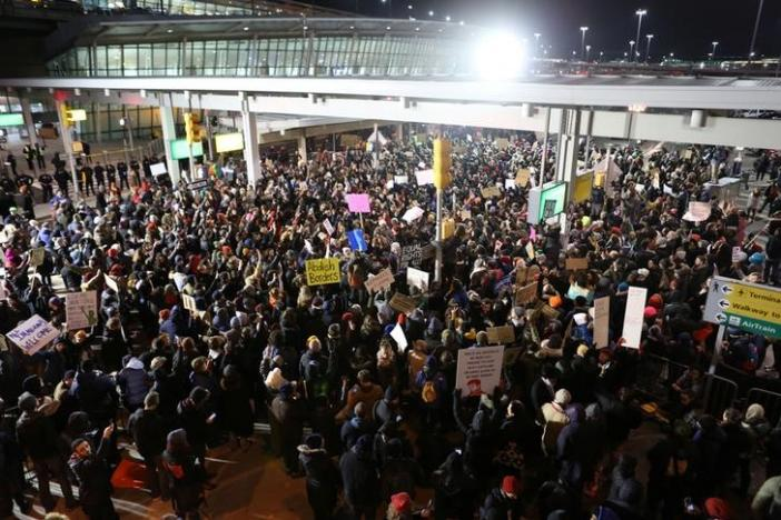 Protestors gather outside Terminal 4 at JFK airport in opposition to U.S. President Donald Trump's proposed ban on immigration in Queens, New York City, New York, U.S. January 28, 2017. REUTERS/Joe Penney