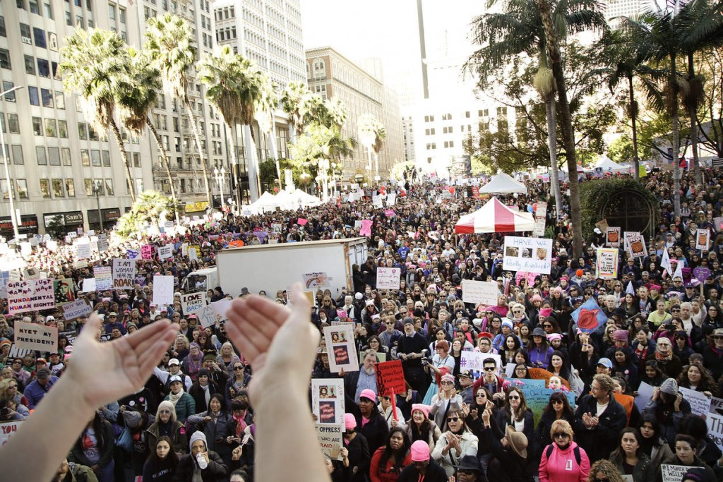 Protesters listen to a speaker as they gather for the Women's March against President Donald Trump Saturday, Jan. 21, 2017, in Los Angeles. The march is being held in solidarity with similar events taking place in Washington and around the nation. (AP Photo/Jae C. Hong) NYTCREDIT: Jae C. Hong/Associated Press