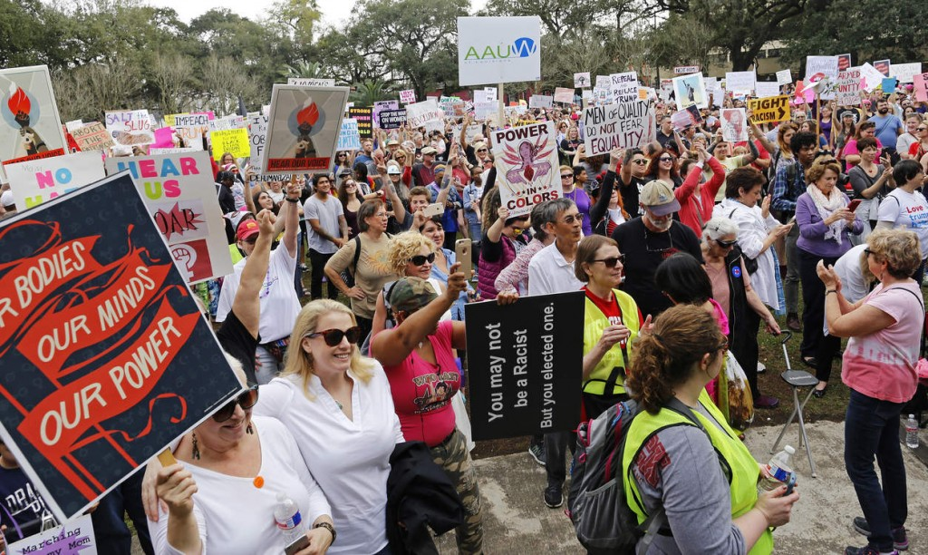 Over 1,000 people gather to take part in a Women's March at Washington Square Park in New Orleans, Saturday, Jan. 21, 2017. (AP Photo/Max Becherer) NYTCREDIT: Max Becherer/Associated Press