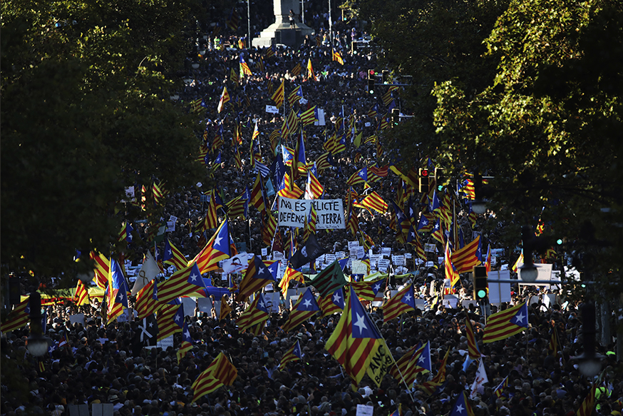 Thousents protesters wave Catalonia independence flags as they take part at a rally against the National Court's decision to imprison civil society leaders, in Barcelona, Spain, Saturday, Oct. 21, 2017. The Spanish government moved decisively Saturday to use a previously untapped constitutional power so it can take control of Catalonia and derail the independence movement led by separatist politicians in the prosperous industrial region.(AP Photo/Emilio Morenatti)