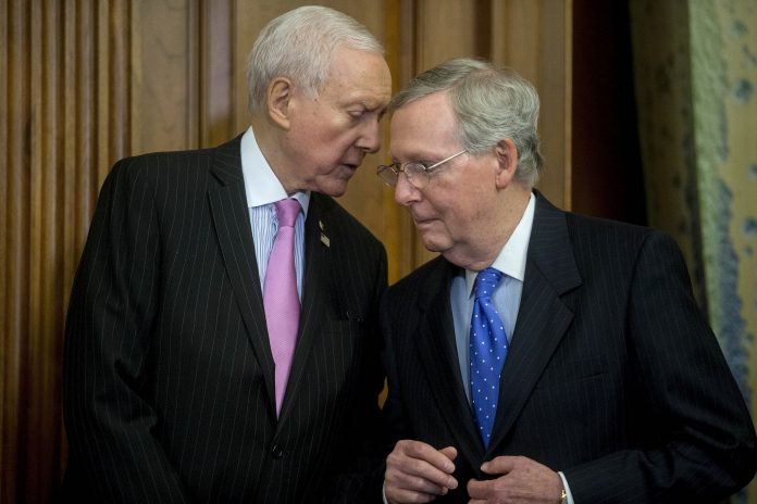 Senate-Majority-Leader-Mitch-McConnell-R-Ky.-right-talks-to-Sen.-Orrin-Hatch-696x464