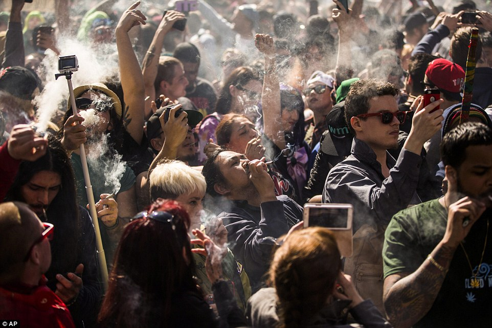33608BA900000578-3550728-Smoking_up_People_gather_to_smoke_marijuana_during_the_420_Toron-a-50_1461193068127