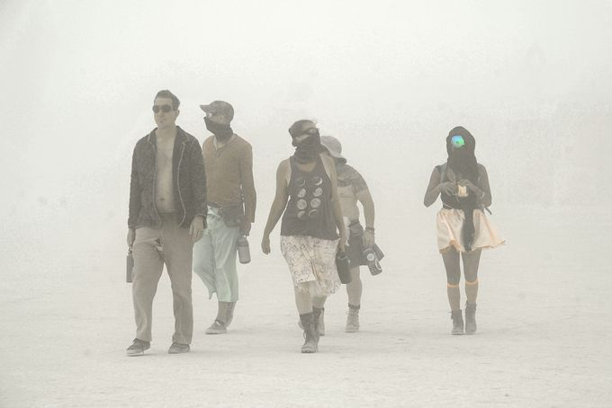 Burning Man attendees, called Burners, walk through a dust storm on the first day of the event, Aug. 26, 2018, in the Nevada desert. The gates into the event had to be closedBurning_Man_4